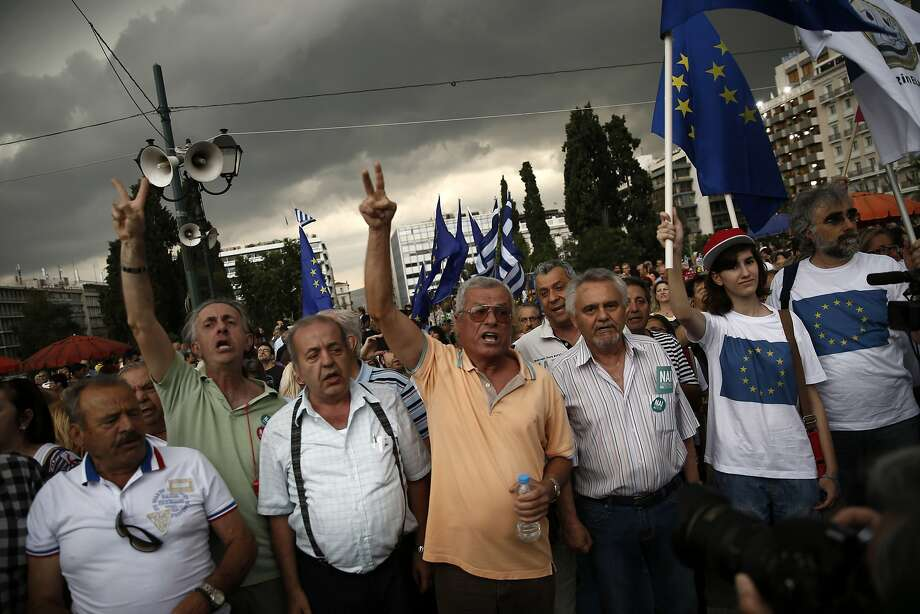 Demonstrators in Athens urge Greece to accept more austerity in exchange for bailout funds. Photo: Daniel Ochoa De Olza, Associated Press