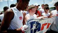 St. Thomas receiver Drew Guidroz makes a touchdown catch against two St. Pius X defensive backs during the TAPPS 7-on-7 state title game, helping the Eagles bring home the championship banner, below, from the inaugural competition.