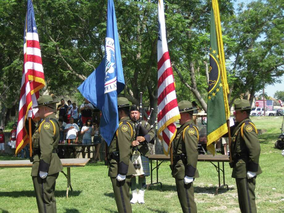The U.S. Border Patrol color guard stands at attention as the bagpiper plays at the start of the annual patriotic program for the Fourth of July celebration at Fort Clark Springs. This year's program begins at 11 a.m. Saturday, following the parade. Photo: Katie Brown /Courtesy