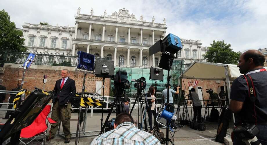 Media are waiting in front of Palais Coburg where closed-door nuclear talks with Iran take place in Vienna, Austria, Monday, June 29, 2015. (AP Photo/Ronald Zak) Photo: Ronald Zak, Associated Press