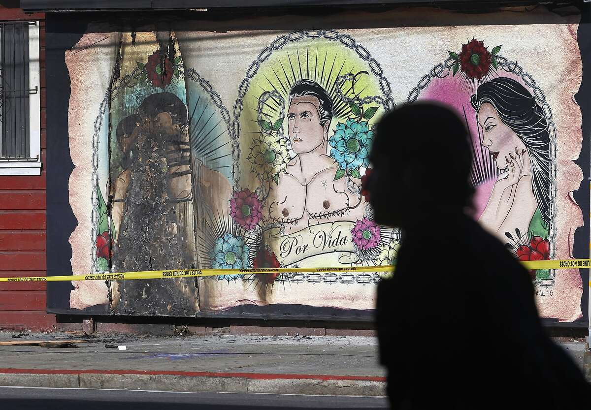 Crime scene tape surrounds a mural at Galeria de la Raza in San Francisco, Calif. on Tuesday, June 30, 2015 after the LGBT-themed artwork was damaged for a third time. Ani Rivera, the gallery's executive director, is deciding whether or not to replace the mural, which was scheduled to be displayed through the end of July.