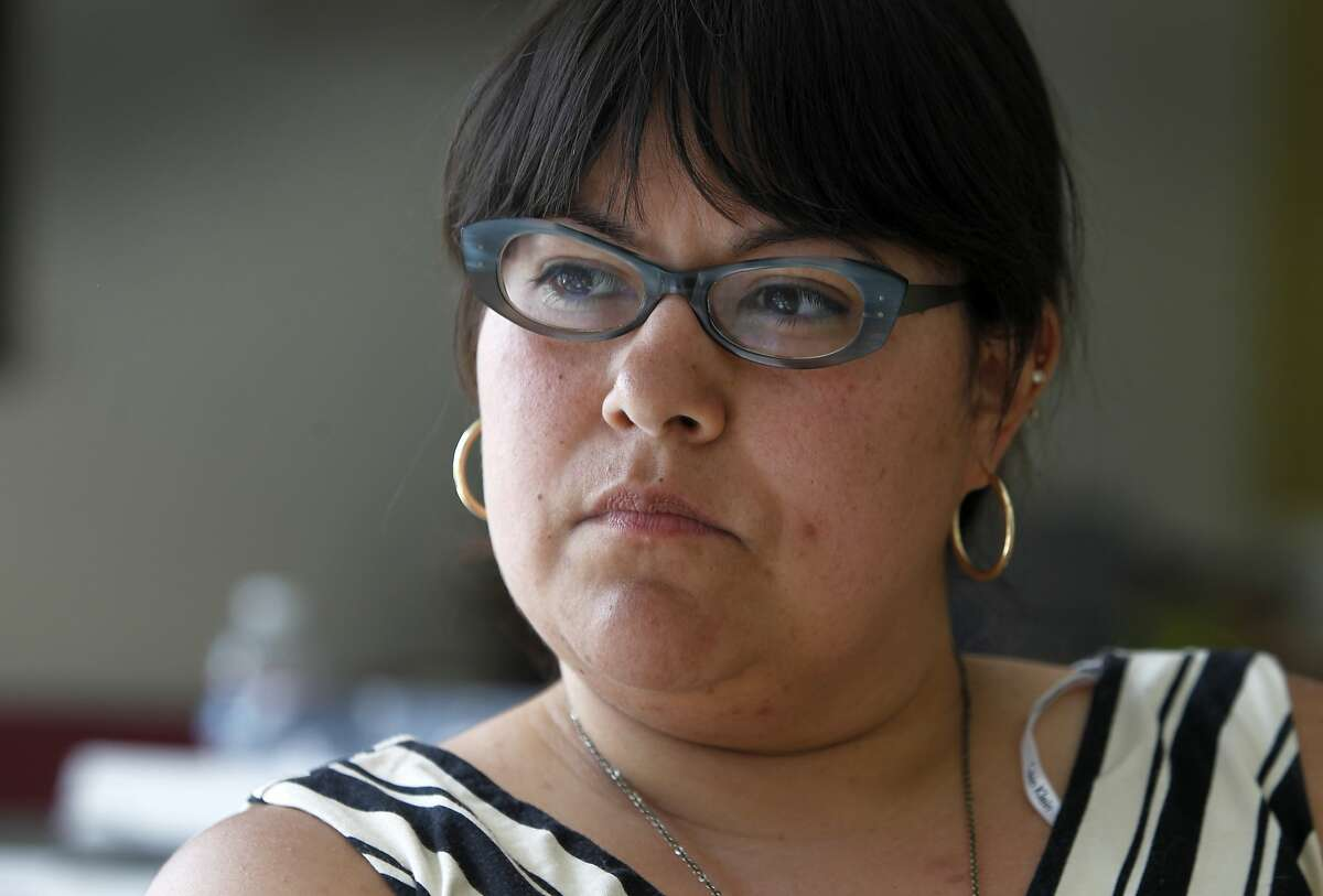 Ani Rivera, the gallery's executive director, is deciding whether or not to replace an LGBT-themed mural which was damaged by vandals for a third time at Galeria de la Raza in San Francisco, Calif. on Tuesday, June 30, 2015.