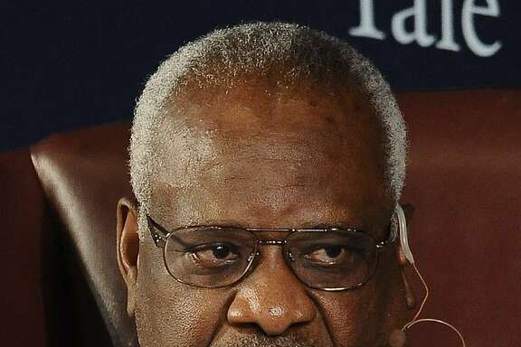 FILE - In this Oct. 25, 2014 file photo, Supreme Court justice Clarence Thomas sits for a conversation at Yale University in New Haven, Conn.  Thomas has taken unusual steps in calling attention to crime victims as the Supreme Court rules in two death-penalty cases. In one case, Thomas dissented from a 5-4 opinion that barred Louisiana from executing Kevan Brumfield, a convicted killer who is mentally disabled. Thomas included a picture of the crime victim at the end of his dissent and even referred to a video of the killer's confession that was posted on the Supreme Court's web site. (AP Photo/Jessica Hill, File)