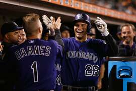 SAN FRANCISCO, CA - JUNE 26:  Nolan Arenado #28 of the Colorado Rockies celebrates in the dugout after hitting a home run in the ninth inning against the San Francisco Giants at AT&T Park on June 26, 2015 in San Francisco, California.  (Photo by Lachlan Cunningham/Getty Images)