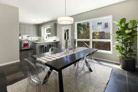 The dining room leads to an open kitchen with professional appliances.