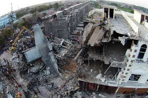 Indonesian C-130 military transport crashes into neighborhood - Photo