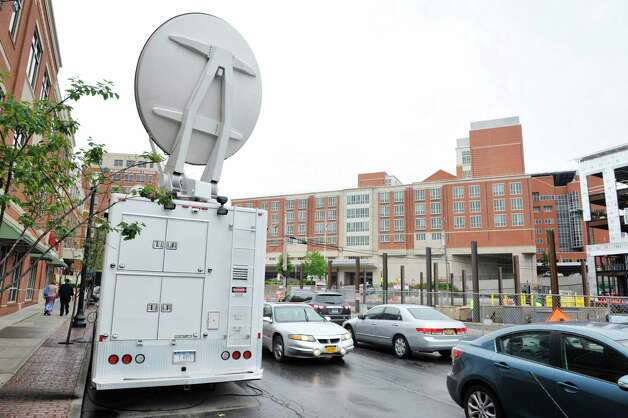 A satellite truck  for the cable news network CNN is seen across the street from Albany Medical Center on Tuesday, June 30, 2015, in Albany, N.Y.  The cable news station is in Albany  covering David Sweat who is being cared for at Albany Med.  (Paul Buckowski / Times Union) Photo: PAUL BUCKOWSKI / 00032440A