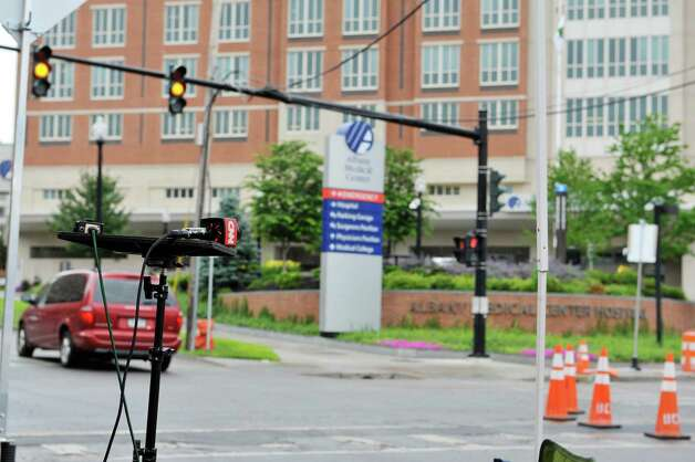 A microphone for the cable news network CNN is seen on a stand across the street from Albany Medical Center on Tuesday, June 30, 2015, in Albany, N.Y.  The cable news station is in Albany  covering David Sweat who is being cared for at Albany Med.  (Paul Buckowski / Times Union) Photo: PAUL BUCKOWSKI / 00032440A