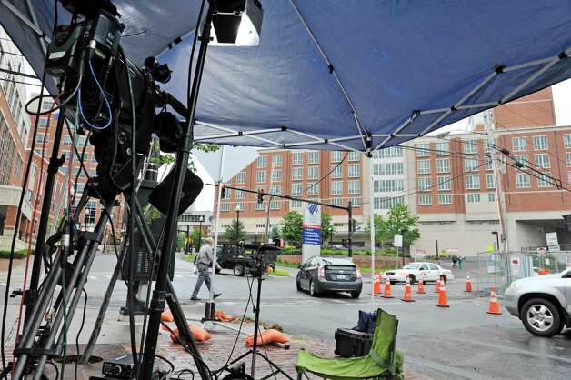 A tent covers a camera and lights for the cable news network CNN which is set up across the street from Albany Medical Center on Tuesday, June 30, 2015, in Albany, N.Y.  The cable news station is in Albany  covering David Sweat who is being cared for at Albany Med.  (Paul Buckowski / Times Union) Photo: PAUL BUCKOWSKI / 00032440A