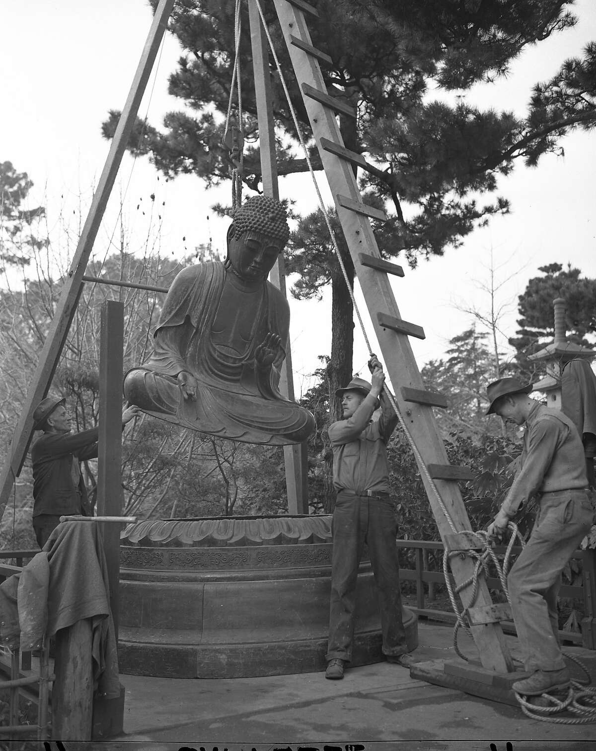 The Buddha at the Japanese Tea Garden in Golden Gate Park being installed in March 1949. It was a gift from the Gump family, and had been in their store for 15 years. photo dated 03/02/1949