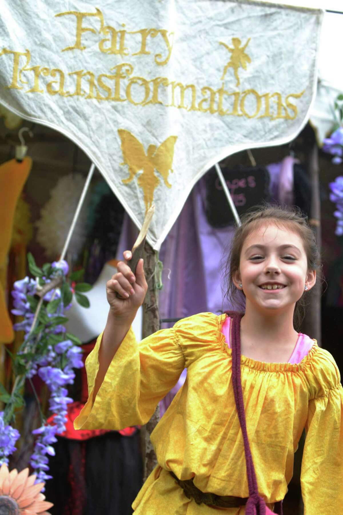 Breena Abbot, eight year old from Machester, Conn. shows off her wooden knife at the Midsummer Fantasy Reinassance Faire at Warsaw Park in Ansonia, Conn. on June 28, 2015. The last weekend of the faire is July 4-5, 2015 from 11 a.m to 6:30 p.m.