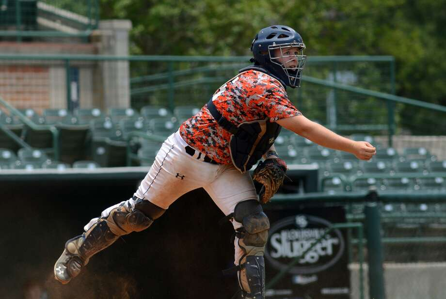 Houston Hurricanes catcher Blake Kent, an Alpha OMega School junior, makes a play against THZ Baseball Round Rock during their pool game at the Southeast ShowcaseSeries at Reckling Park on the campus of Rice University in Houston on Friday, June 26, 2015. (Photo by Jerry Baker/Freelance) Photo: Jerry Baker, Freelance
