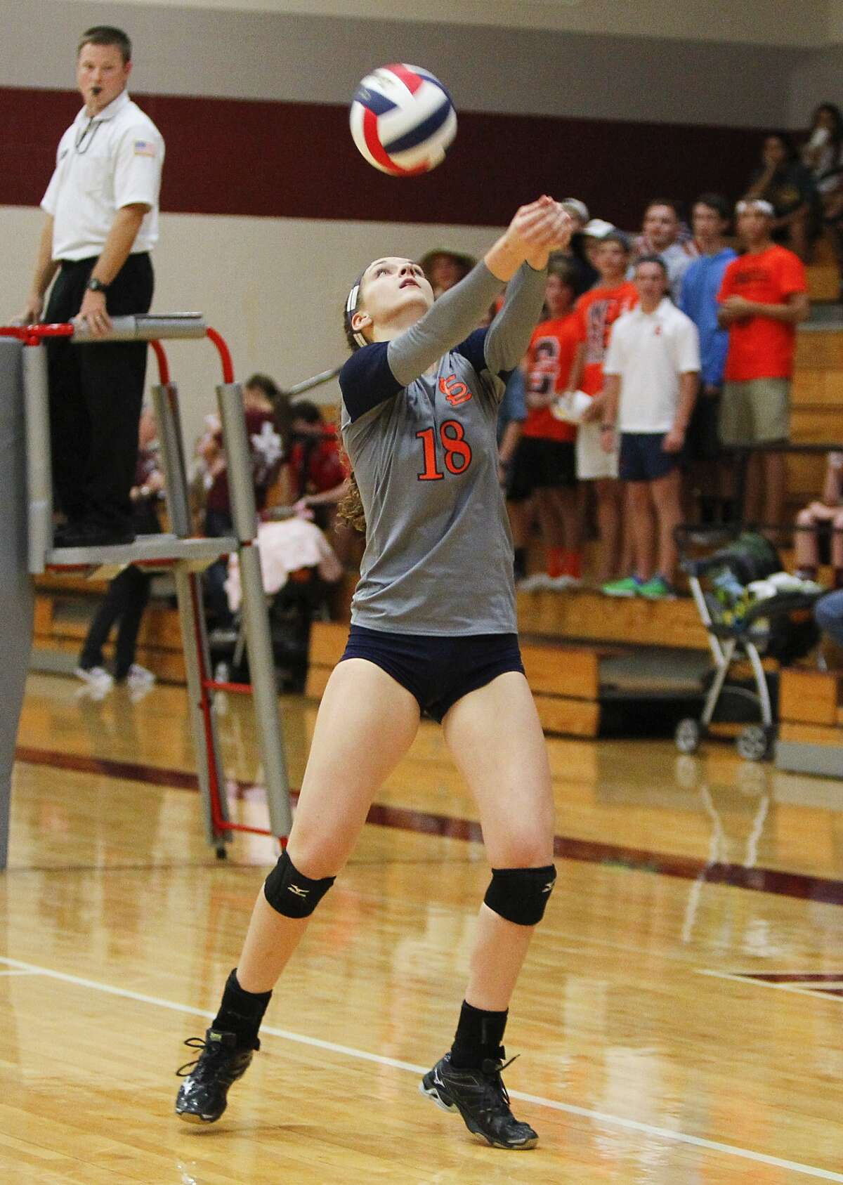 Seven Lakes' Camille Conner volleys the ball back to Cinco Ranch as they two teams faced off at Cinco Ranch High School in Katy on September 26, 2014.