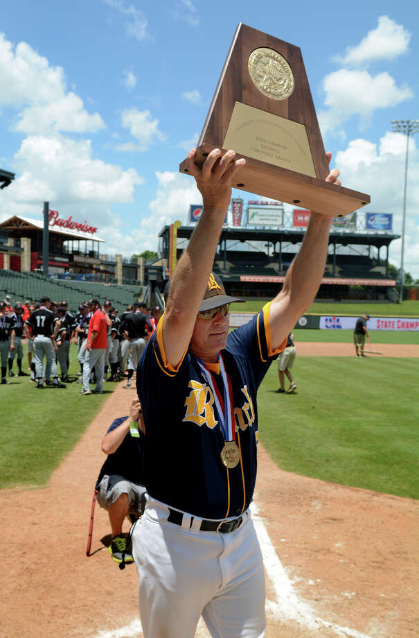 Cy Ranch head coach John Pope presents his team's trophy after their 3-0 win over Arlington Martin in the 2015 UIL Class 6A State Baseball Championship final at Dell Diamond in Round Rock on Saturday, June 13, 2015. (Photo by Jerry Baker/Freelance) Photo: Jerry Baker, Freelance