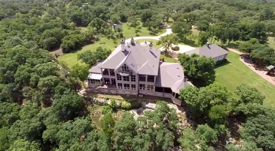 This 801-acre ranch in Kerrville is on the market for $18.5 million. The 9,000-square-foot home has five bedrooms and 4.5 bathrooms, but there are three smaller houses scattered throughout the property. Horse barns, water wells, working pens and a greenhouse are also located on the ranch.Source: Evans & Associates Real Estate Photo: Courtesy, Doug Evans, Evans & Associates Real Estate