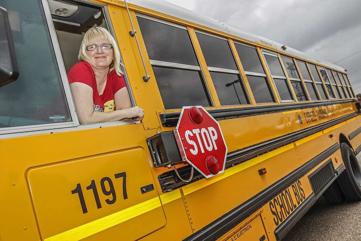 Cy Fair ISD school bus driver LesLee Hall sits in the driver's seat of her bus at the CyFair ISD Falcon Center in Cypress.