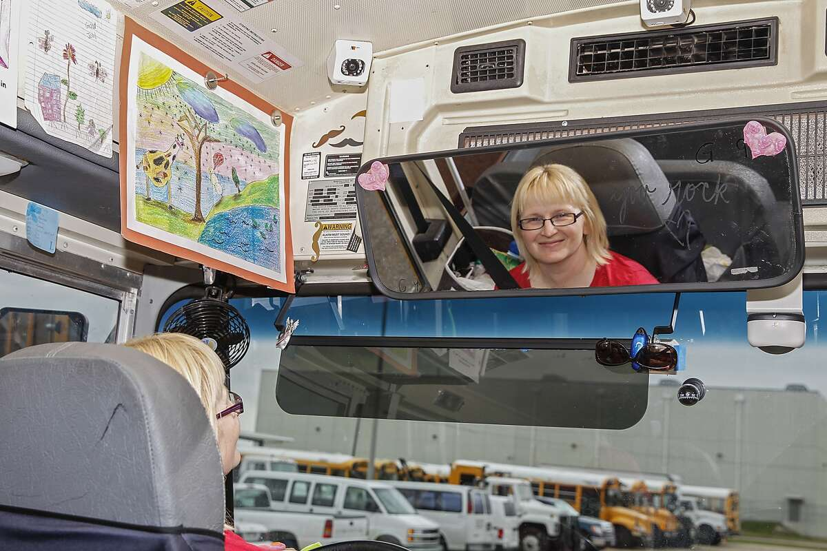 Cy Fair ISD school bus driver LesLee Hall shows all of the drawings given to her by the children who ride her bus at the CyFair ISD Falcon Center.