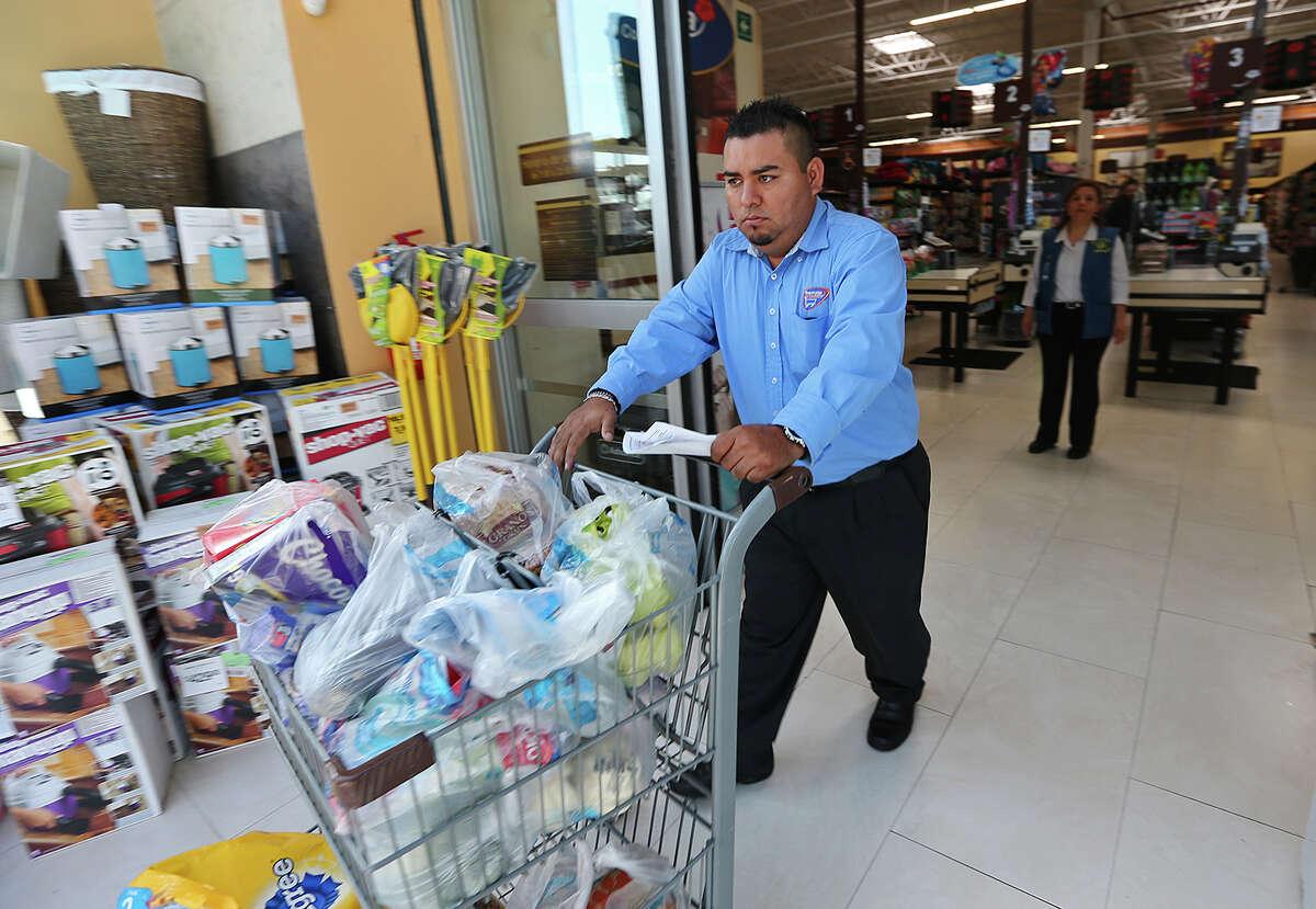 Obregon fills out a phone order at Walmart's Superama story in San Pedro Garza Garcia, Mexico.