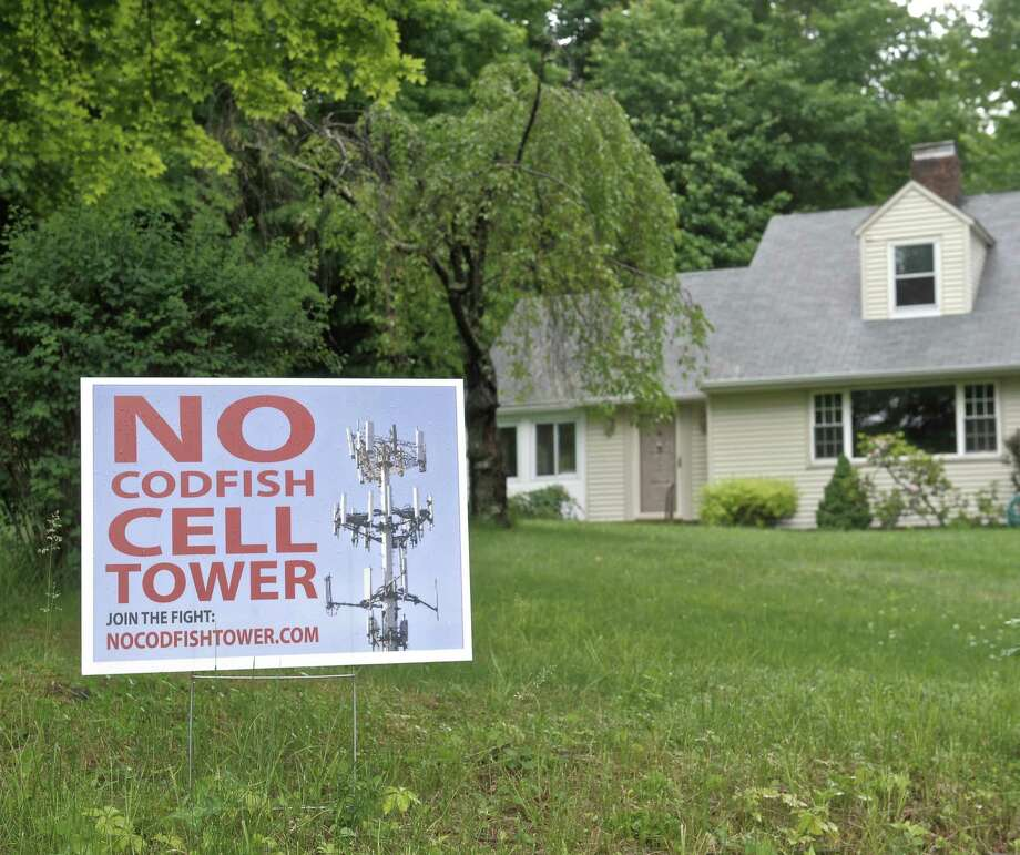 A sign on the front lawn of a house next to the property of a proposed new cell tower on Codfish Hill Road, in Bethel, Conn, on Tuesday, June 2, 2015. Photo: H John Voorhees III / Hearst Connecticut Media / The News-Times
