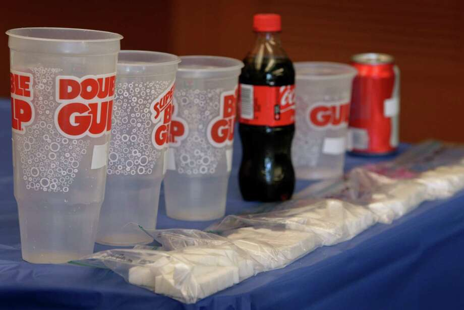 A display illustrates the amount of sugar contained in soft drinks, from a can to a 64-oz Double Gulp Photo: Paul Chinn, Staff / ONLINE_YES