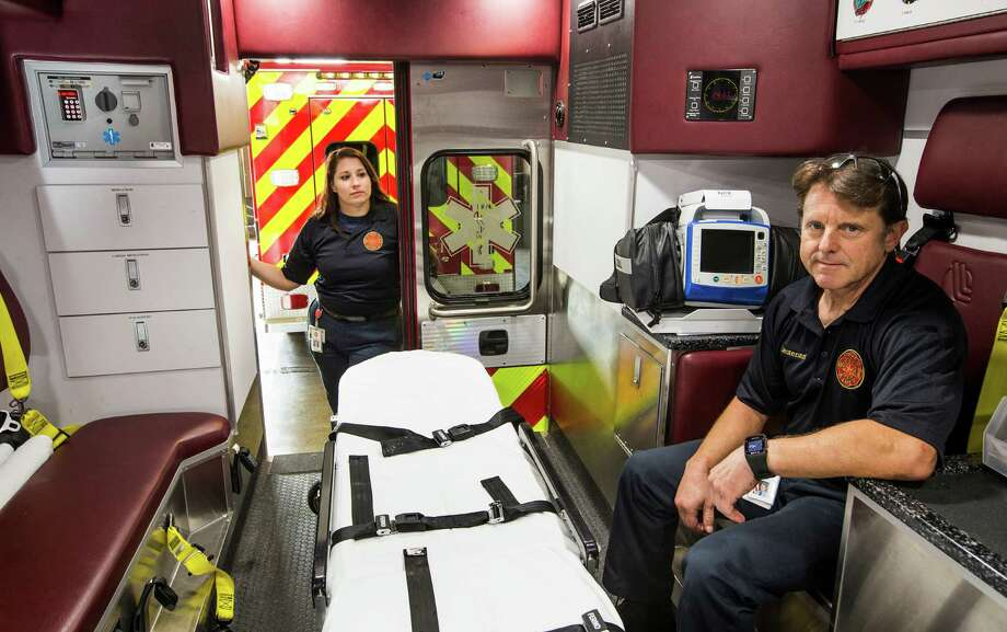 Paramedics Laura Deverteuil, left, and Lt. John Hanna pose for a photo in the back of an ambulance at Sugar Land Fire Station 1 on Tuesday, June 30, 2015, in Sugar Land. The city fire department is operating its ambulances without  controlled substances like painkillers and seizure medications. Sugar Land officials are working to getting licensing to such medications, a fire official said. Photo: Brett Coomer, Houston Chronicle / © 2015 Houston Chronicle