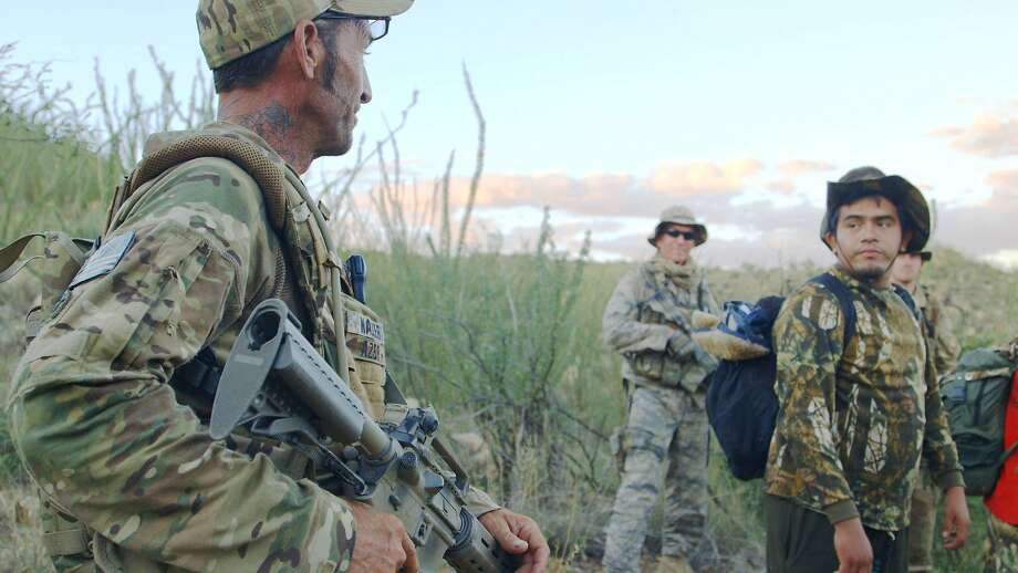 "Tim ""Nailer"" Foley (left) guards the Arizona-Mexico border with a small paramilitary group trying to keep the U.S. from becoming a narcotics battleground in ""Cartel Land."" Photo: The Orchard"