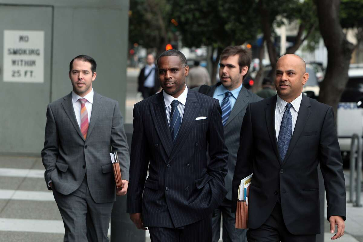Keith Jackson, second from left, and his legal team walk up to the Phillip Burton Federal Courthouse for a hearing on expanded indictment charges of racketeering and various counts of corruption, money laundering and trafficking in weapons and drugs on Thursday, August 7, 2014 in San Francisco, Calif. Co-defendants, former state Sen. Leland Yee and Raymond