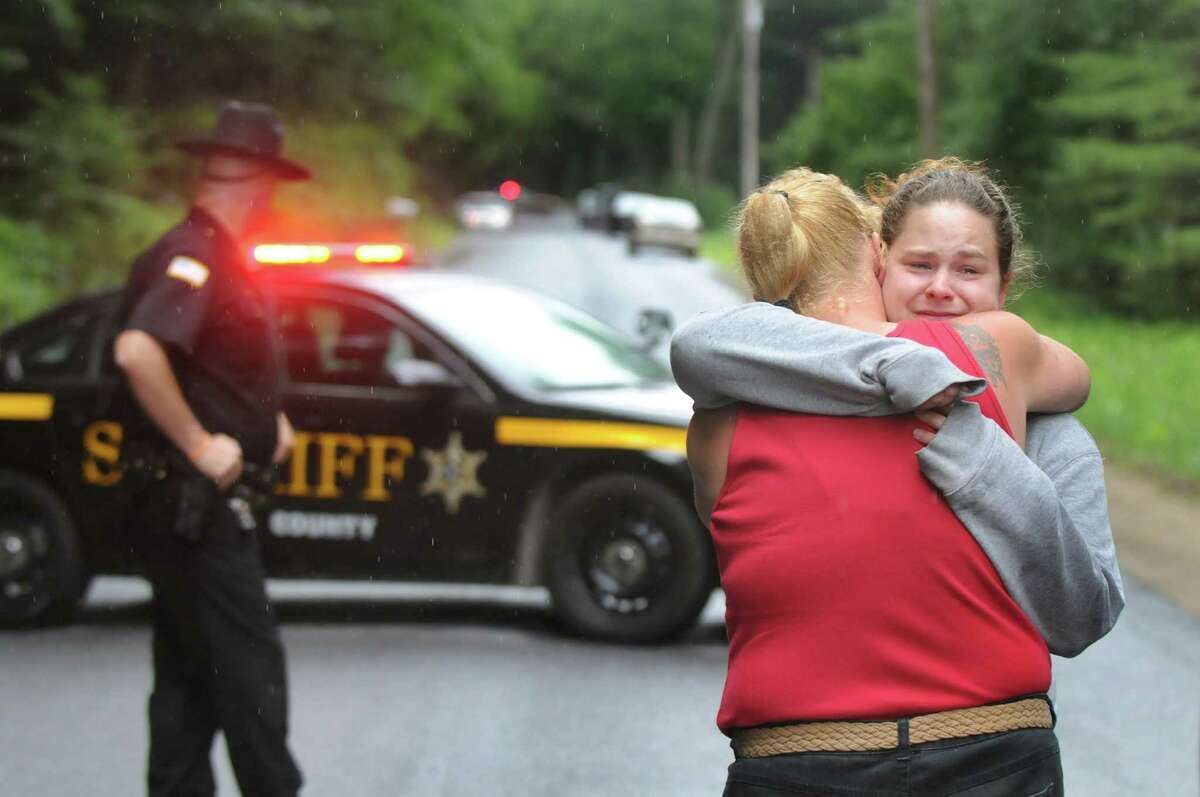 Mindy Laport, daughter of Richard Laport, right, embraces her friend Lisa Burroughs on Tuesday, June 30, 2015, in Edinburg, N.Y. Richard Laport, 51, died after an encounter with officers. (Cindy Schultz / Times Union)