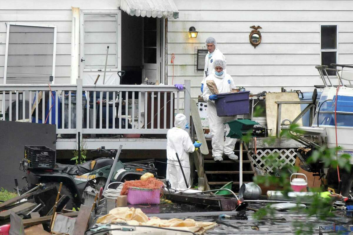 State Police forensic investigators scour for evidence at 96 Fox Hill Rd. on Tuesday, June 30, 2015, in Edinburg, N.Y. Resident Richard Laport, 51, died after an encounter with officers. (Cindy Schultz / Times Union)