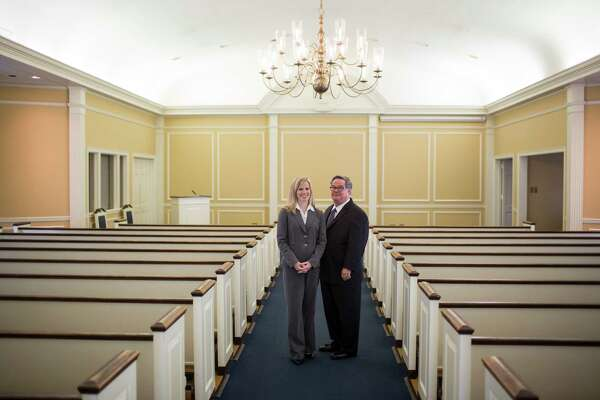 Helen Loring Dear and her father Porter Loring III stand for a portrait at the Porter Loring Mortuary in San Antonio in June. Founded in 1918, it is one of the largest family-owned funeral homes in Texas.