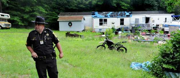 Saratoga County Sheriff Sgt. Michael Bortell on the scene of 96 Fox Hill Rd. on Tuesday, June 30, 2015, in Edinburg, N.Y. Resident Richard Laport, 51, died after an encounter with officers. (Cindy Schultz / Times Union) Photo: Cindy Schultz / 00032443A