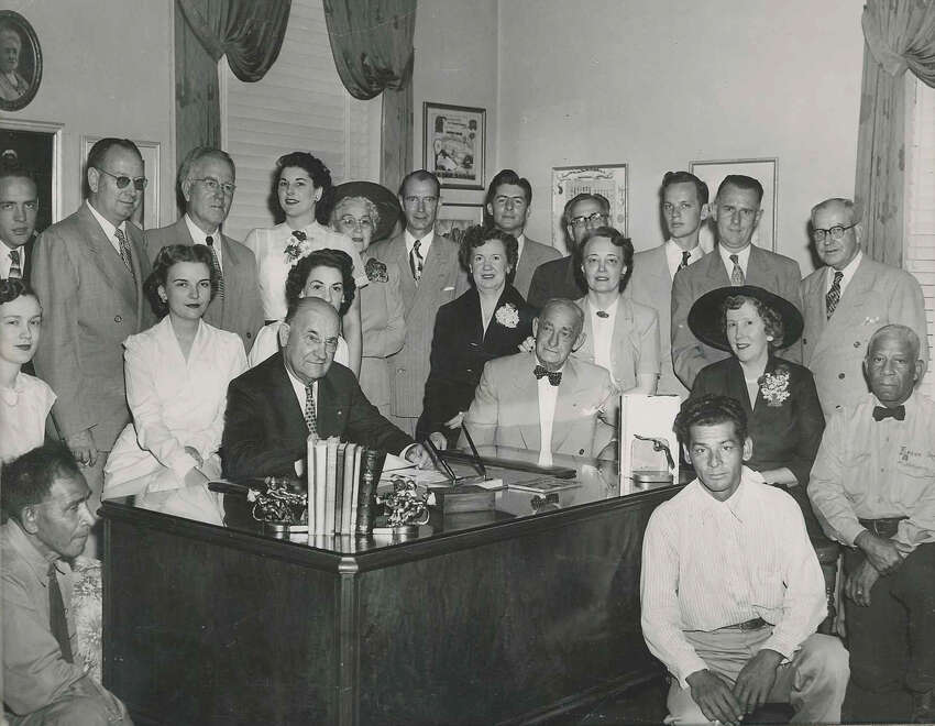 A group photo of Porter Loring Funeral Home and its employees.The company was founded in 1918 by Porter Loring and is now managed by a fourth generation family member.