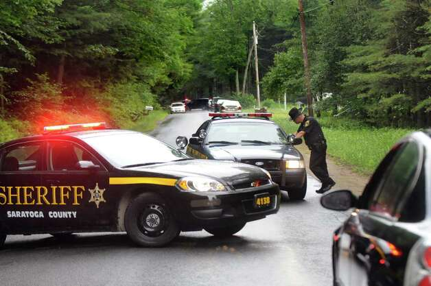 Saratoga County Sheriff Deputy Joe Salisbury, center, monitors traffic on Fox Hill Road on Tuesday, June 30, 2015, in Edinburg, N.Y. Resident Richard Laport, 51, died after an encounter with officers. (Cindy Schultz / Times Union) Photo: Cindy Schultz / 00032443A