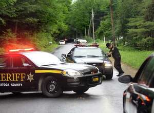 Saratoga County Sheriff Deputy Joe Salisbury, center, monitors traffic on Fox Hill Road on Tuesday, June 30, 2015, in Edinburg, N.Y. Resident Richard Laport, 51, died after an encounter with officers. (Cindy Schultz / Times Union)