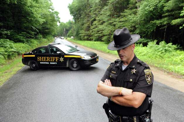 Saratoga County Sheriff Deputy Joe Salisbury keeps the media and others from entering Fox Hill Road on Tuesday, June 30, 2015, in Edinburg, N.Y. Resident Richard Laport, 51, died after an encounter with officers. (Cindy Schultz / Times Union) Photo: Cindy Schultz / 00032443A