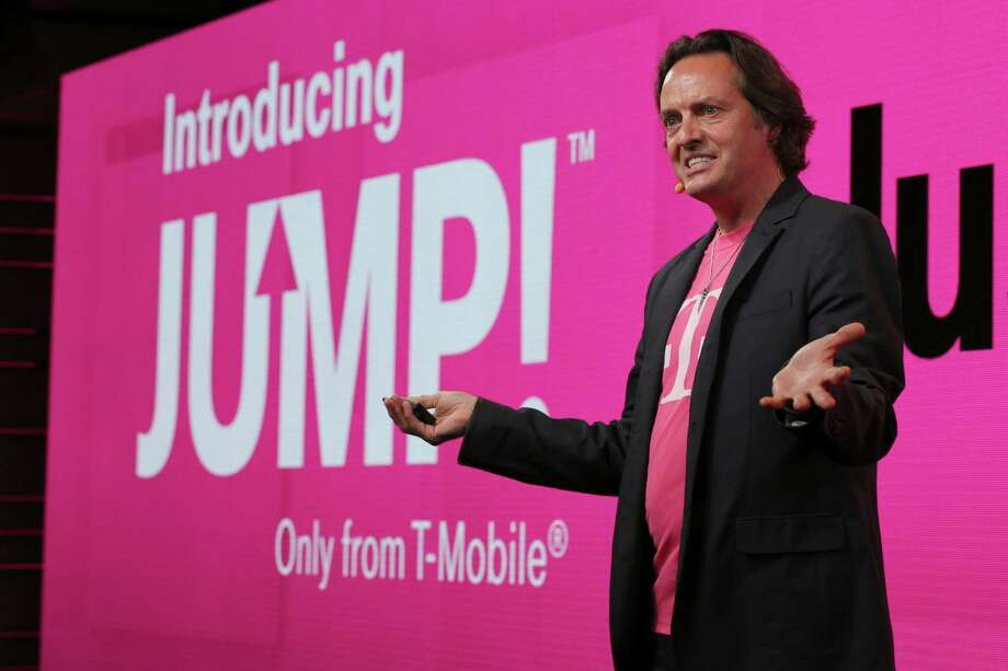 T-Mobile CEO John Legere talks about the company's Jump plan a year ago. T-Mobile is revamping its Jump phone-upgrade program by eliminating a $10-a-month charge for the most popular phones. Photo: Mary Altaffer /Associated Press / AP
