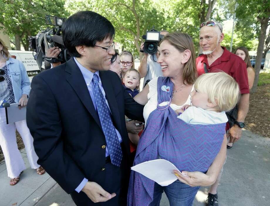 Calif. state Sen. Richard Pan, is thanked by Leah Russin, with her son, Leo, after Pan's vaccination bill was signed by Gov. Jerry Brown on Tuesday. 