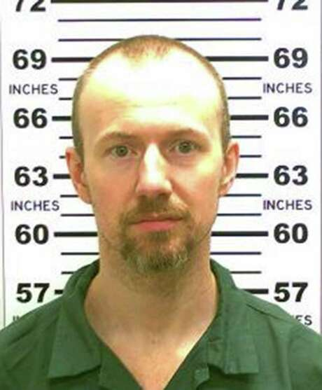 FILE - JUNE 27:  According to reports June 27, 2015, David Sweat, the inmate who escaped from an Upstate New York prison, has been shot and captured near the Canadian border. UNDATED:   In this handout from New York State Police, convicted murderer David Sweat (L) is shown. Richard Matt, 48, and Sweat, 34, escaped from the maximum security prison June 6, 2015 using power tools and going through a manhole.  (Photo by New York State Police via Getty Images) Photo: Handout / 2015 New York State Police