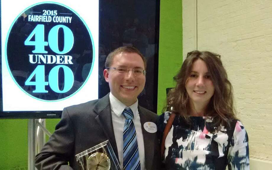 Daniel Ksepka and his wife Kristin Lamm celebrate Ksepka being named to the 2015 Fairfield County 40 Under 40 of people who are making a mark on the community. Ksepka is the science coordinator at the Bruce Museum. Photo: Contributed / Contributed Photo / Greenwich Time Contributed