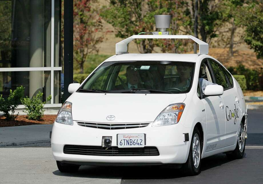 Driverless cars, such as the one shown in this file photo, are in our near future. And the current model for auto insurance will change, too. Photo: Eric Risberg /Associated Press / AP