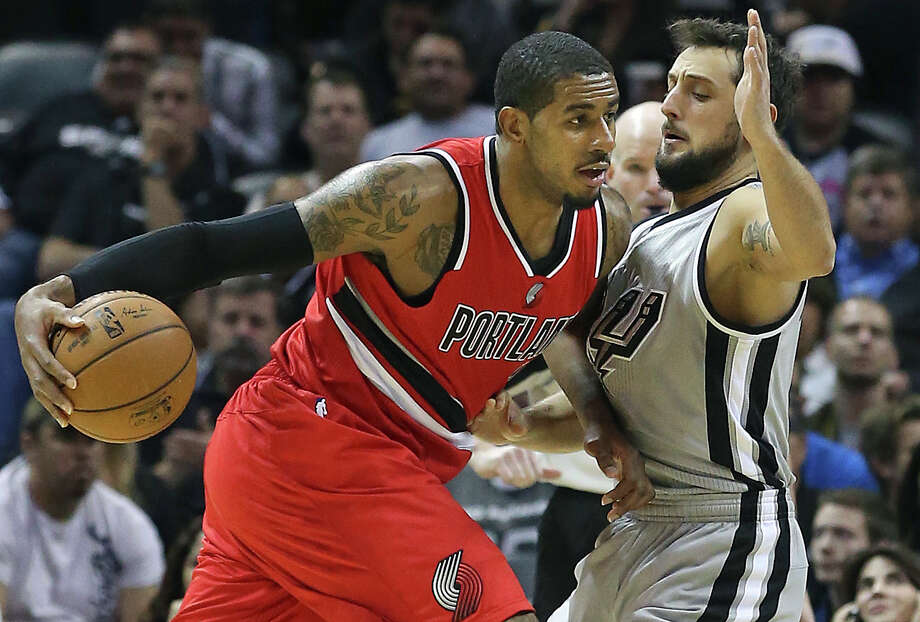 LaMarcus Aldridge moves on Marco Belinelli as the Spurs host the Portland Trailblazers at the AT&T Center on December 19, 2014. Photo: TOM REEL