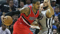 LaMarcus Aldridge moves on Marco Belinelli as the Spurs host the Portland Trailblazers at the AT&T Center on December 19, 2014.