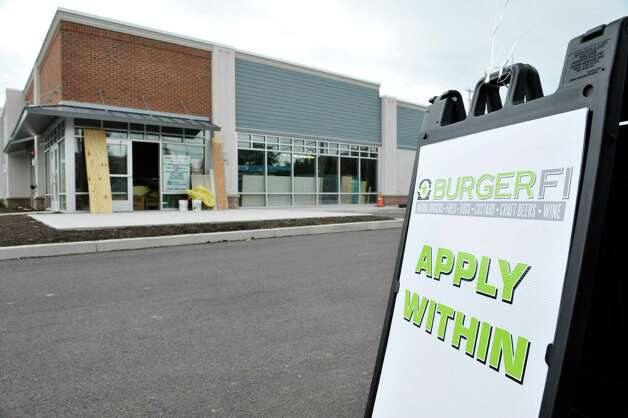 Construction work continues on the new business, BurgerFi as company officials held a job fair at the site on Tuesday, June 30, 2015, in Latham, N.Y.  The business plans to open by end of the month.  Potential hires can stop by the location at 860 New Loudon Road from 9am to 5pm Monday through Friday to apply for one of 50 positions the company is looking to fill.   (Paul Buckowski / Times Union) Photo: PAUL BUCKOWSKI / 00032440A