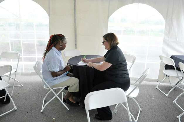 Job applicant, Shana Gourdine, left, of Troy, interviews with BurgerFi general manager, Meredith Mercier during a job fair on Tuesday, June 30, 2015, in Latham, N.Y.  The business plans to open by end of the month.  Potential hires can stop by the location at 860 New Loudon Road from 9am to 5pm Monday through Friday to apply for one of 50 positions the company is looking to fill.    (Paul Buckowski / Times Union) Photo: PAUL BUCKOWSKI / 00032440A