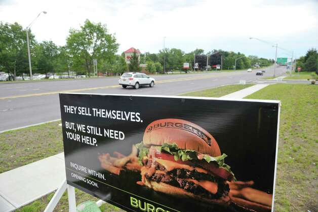 An advertisement for job applicants is seen outside the BurgerFi business on Tuesday, June 30, 2015, in Latham, N.Y.  The company held a job fair on Tuesday.  The business plans to open by end of the month.  Potential hires can stop by the location at 860 New Loudon Road from 9am to 5pm Monday through Friday to apply for one of 50 positions the company is looking to fill.    (Paul Buckowski / Times Union) Photo: PAUL BUCKOWSKI / 00032440A