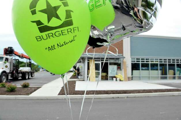Balloons mark the area for job applicants to come to as construction work continues on the BurgerFi business on Tuesday, June 30, 2015, in Latham, N.Y.  The business plans to open by end of the month.  Potential hires can stop by the location at 860 New Loudon Road from 9am to 5pm Monday through Friday to apply for one of 50 positions the company is looking to fill.    (Paul Buckowski / Times Union) Photo: PAUL BUCKOWSKI / 00032440A