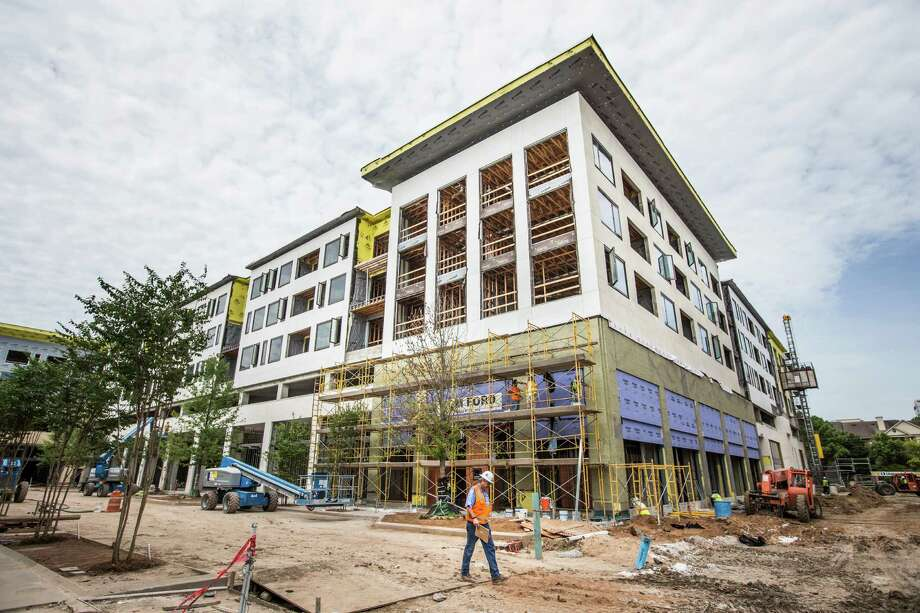 Construction on the River Oaks District has continued this summer as leasing plans firmed up. Several retailers plan to open Oct. 1 Photo: Brett Coomer, Staff / © 2015 Houston Chronicle