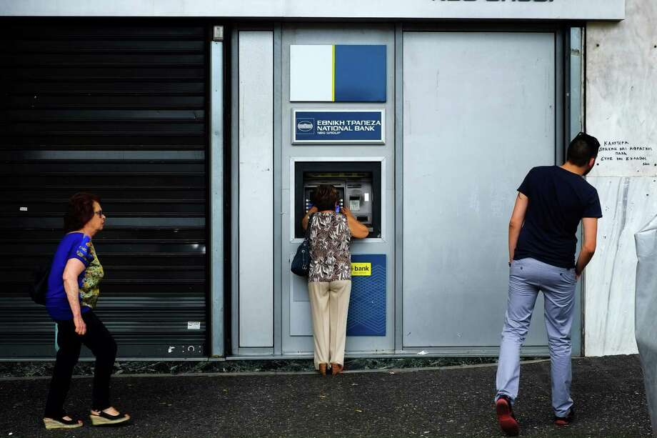 Up and ATMCheck your bank or credit-card company for their rules on using overseas ATMs and foreign transaction fees. And let them know where you'll be so you don't get frozen out for possible fraud.Source: Travel + Leisure Photo: Petros Karadjias, STF / AP