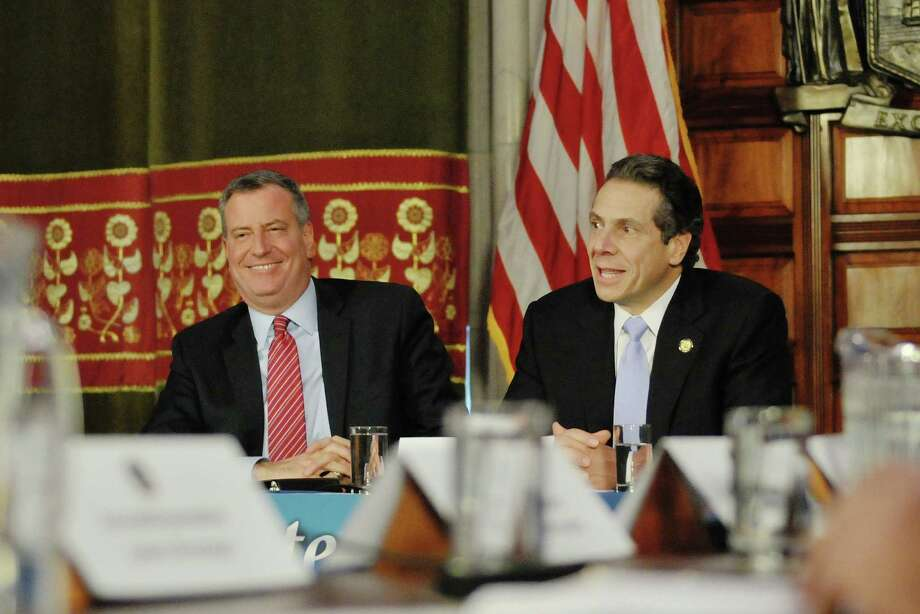 New York Mayor Bill de Blasio, left, and New York Governor Andrew Cuomo take part in a press conference at the capitol on Monday, Jan. 27, 2014 in Albany, NY.  The Governor and the Mayor along with city legislators held the press conference to discuss the Brooklyn hospital crisis.   (Paul Buckowski / Times Union) Photo: Paul Buckowski / 00025523A