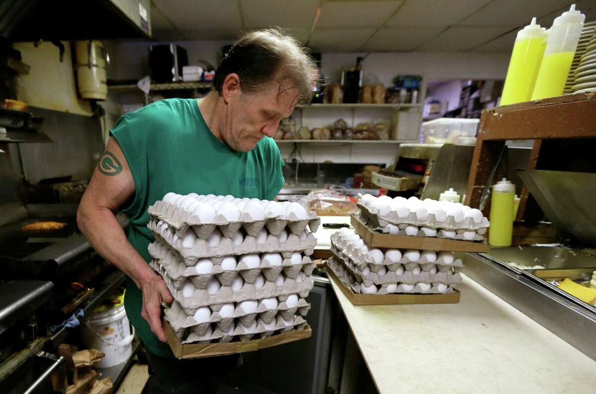 Nick Wells puts eggs in a cooler at the Waveland Cafe, Friday, June 19, 2015, in Des Moines, Iowa. Restaurants are struggling to deal with higher egg prices and an inability to get enough eggs and egg products in the midst of a shortage brought about by a bird flu virus that wiped out millions of chickens on commercial farms this spring. (AP Photo/Charlie Neibergall)